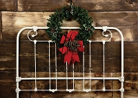 Vintage Iron Headboard with lit wreath